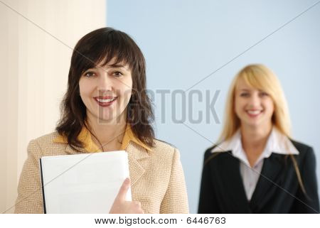 Blonde And Brunette Women In Office