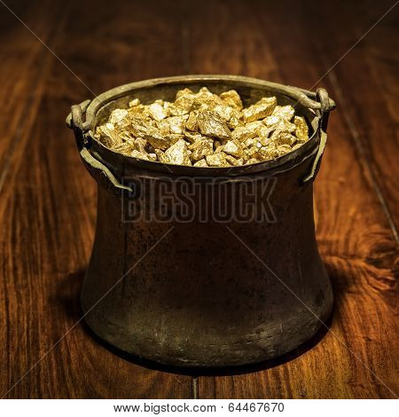 Pot Full Of Gold On A Wooden Background