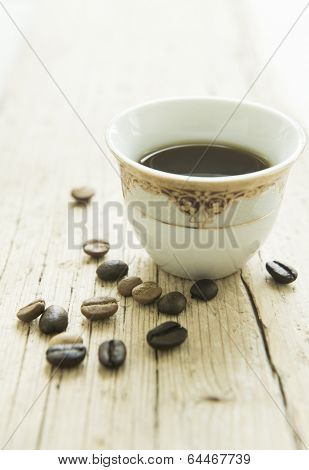 A cup of arabic coffee and beans