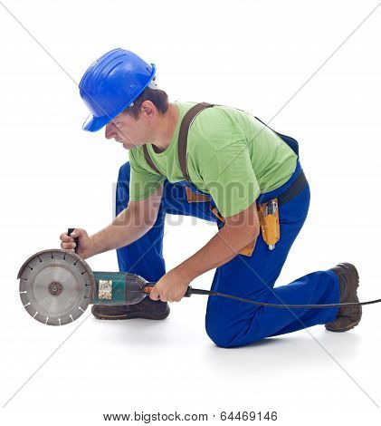Worker With A Power Grinder