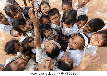 SIEM REAP -DECEMBER 04: group of joyful kids posing in a schoolyard on December 04, 2012 in Siem Reap, Cambodia