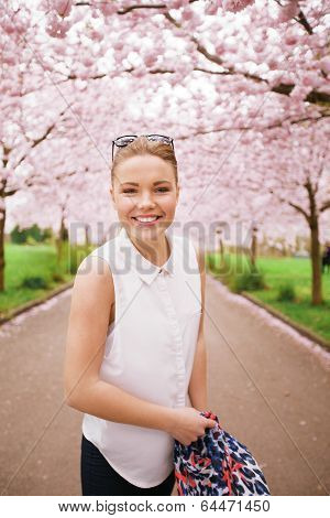 Happy Young Woman At Spring Blossom Garden