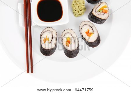 Maki Sushi : Maki Rolls and California rolls made of fresh raw Salmon(sake), Tuna(maguro) and Eel(unagi) . on white dish with sticks isolated over white background