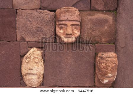 Closeup Of Carved Stone Tenon-heads Embedded In Wall Of Tiwanaku's Semi-subterranean Temple