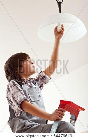 Boy Changing Lightbulb
