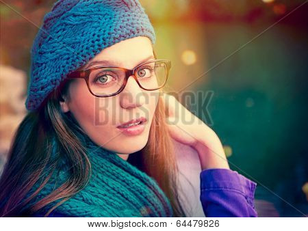 beauty portrait of a girl with glasses