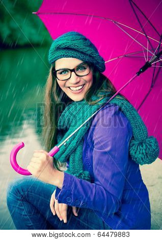 girl with pink umbrella in the rain