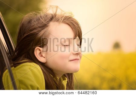 Beautiful Little Girl Enjoying Nature