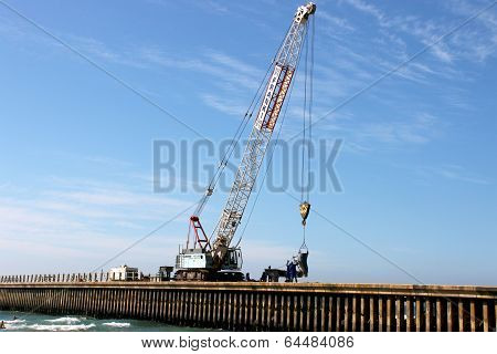 Workers And Mobile Crane On Construction Site