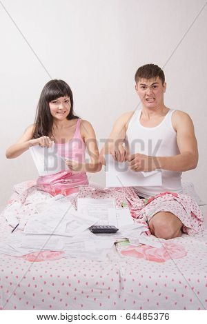 Newlyweds Sitting In Bed Tearing Account For Rent