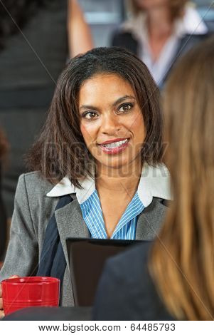 Woman Talking With Coworker