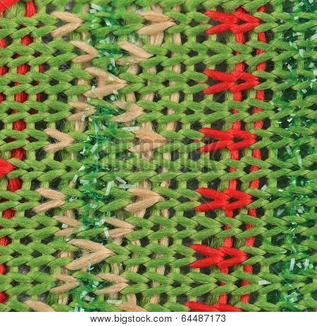 Close up of knitted fabric texture with dots.