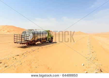 Abandoned Truck Among Sand Dunes In Oman Desert (oman)
