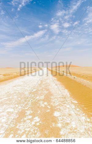 Dirt Road Among Sand Dunes In Desert (oman)