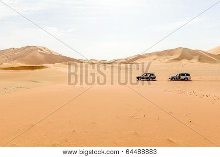 Cars Among Sand Dunes In Oman Desert (oman)
