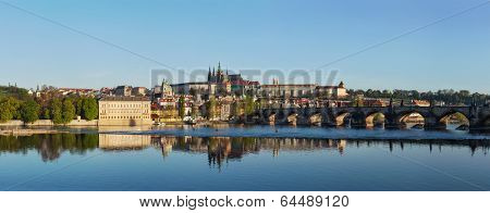 View of historic center of Prague: Charles bridge over Vltava river and Gradchany (Prague Castle) and St. Vitus Cathedral in the morning
