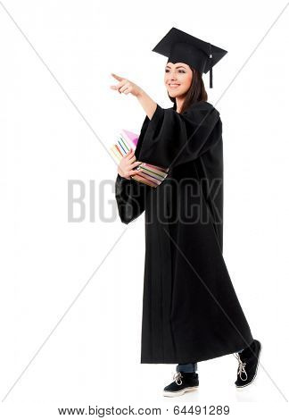 Young graduate girl student in mantle with books, isolated on white background