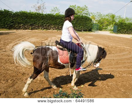 Teenage Girl On Horseback Wearing Helmet