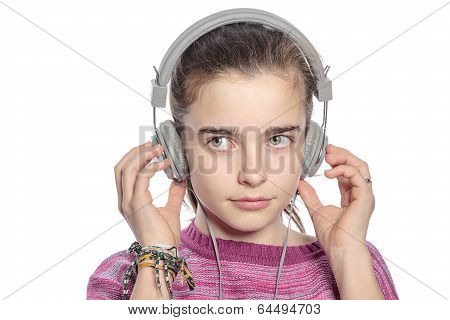 Female Teenager With Headphones Hearing Music, Isolated On White