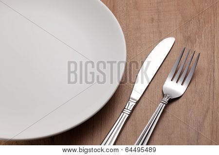 Fork And Knife On Wood Table