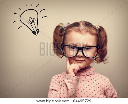Thinking Happy Kid In Glasses With Idea Bulb Above The Head