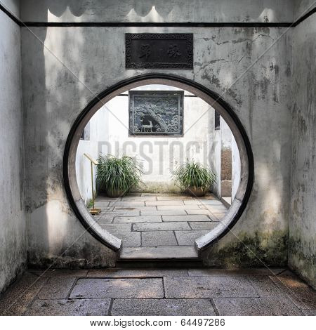 Round doorway in ancient Yu Yuan Garden in Shanghai, China