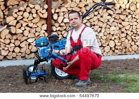 Man With Cultivator Machine