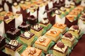 foto of catering  - Varieties of cakes individual decorative desserts on the table at a luxury event gourmet catering sweets - JPG