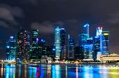 stock photo of singapore night  - The skyline of Singapore at night from across Marina Bay - JPG