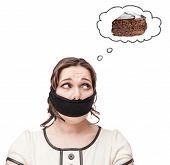 pic of gag  - Gagged beautiful brunette plus size woman dreaming about cake isolated - JPG