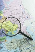 picture of political map  - Magnifying glass over the map of Ukraine to emphasize the concern of the international community over the political and military crisis in that area - JPG