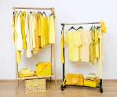 stock photo of shoe-box  - Wardrobe full of all shades of yellow clothes - JPG