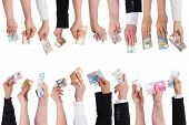 stock photo of word charity  - a lot of hands with important currencies isolated on white - JPG