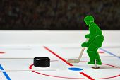 foto of bandy stick  - Toy hockey player in a center of field - JPG