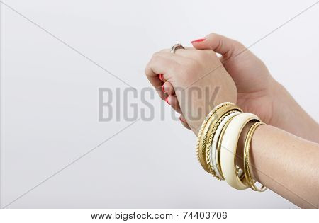 Woman's Hands With Yellow Bracelets
