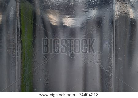 Photo of the old uneven glass