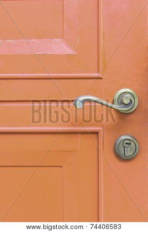 Classic Door Handle On Orange Door