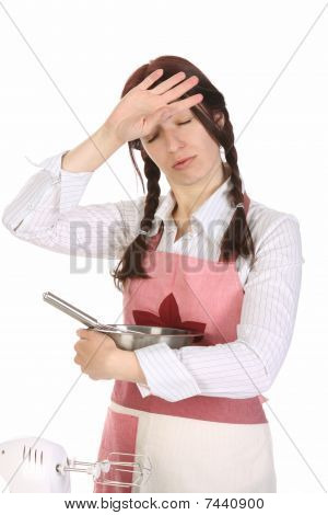 Tired Housewife Preparing With Egg Beater