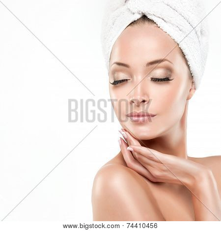 Spa Girl  with clean skin . Beautiful Young Woman After Bath Touching Her Face