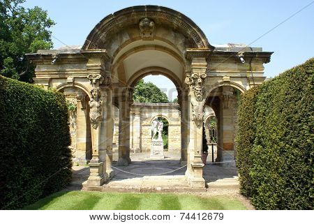 ornate Italian archway with statues