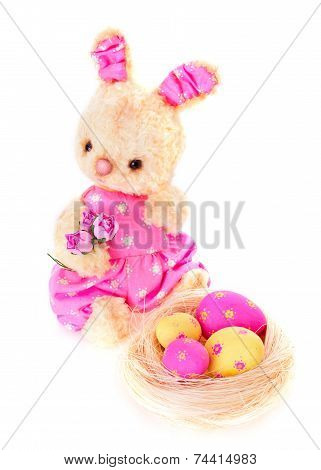 Rabbit Bunny Toy With Eggs On The Nest Isolated In Hand