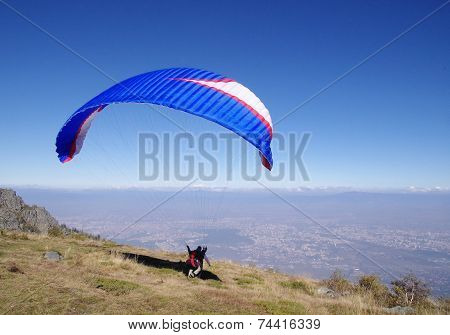 Blue Paraglider Over City Sofia, Bulgaria