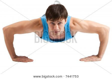 Handsome Young Man Making Push-ups. Isolated