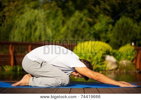 Young man practising yoga