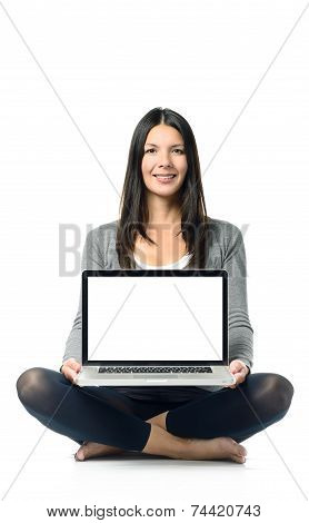 Smiling Woman Displaying Her Blank Laptop Screen