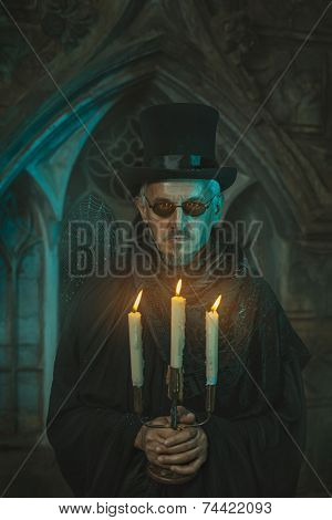 Scary Man With Candles In The Candelabra.