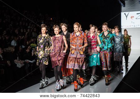 MOSCOW - OCTOBER 22: Models display the creation by Russian designer Yegor Zaitsev during Mercedes-Benz Fashion Week Russia on October 22, 2014 in Moscow, Russia.