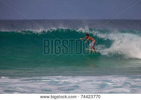 Young Surfer Riding