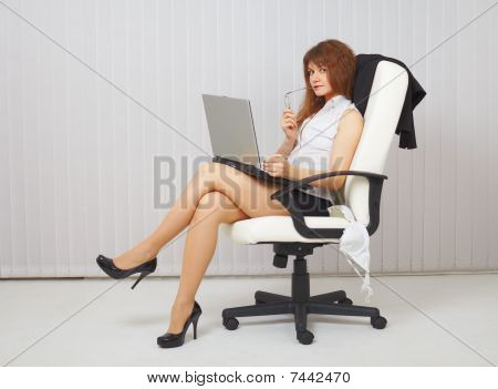 Sexy Young Woman With Computer In Office Chair