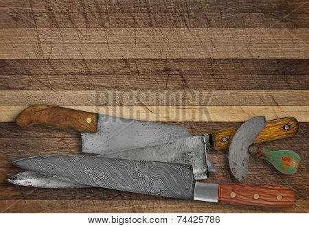 vintage kitchen knives over cutting board, space for your text